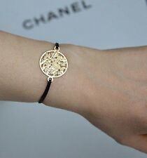 AUTH CHANEL SUBLIMAGE GOLD DISC BLACK CORD BRACELET BNIB