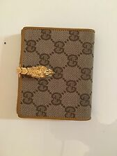 Gucci Monogram Canvas And Leather Beige Bifold Wallet Gold Dragon Closure