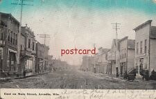 1914 ARCADIA WI East on Main Street, dirt road, mailed to Miss Olga Neggle