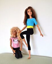 Two Made to Move Barbie dolls