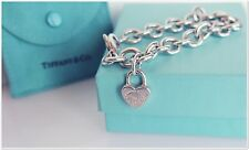 Tiffany Co Sterling Silver Charm Bracelet with Tiffany Co Heart Padlock Charm