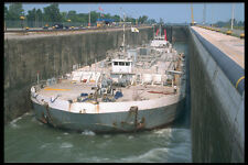 491060 Barge Being Raised Welland Canal A4 Photo Print