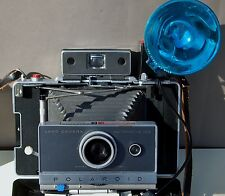 Polaroid Automatic 100 Land Camera with case, flash, bulbs & Close-up attachment