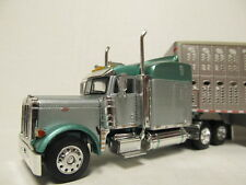 DCP 1/64 SCALE 379 PETERBILT STANDUP  SILVER & GREEN  WITH CATTLE TRAILER #30589