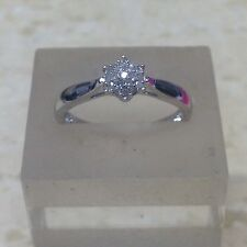 9ct 0.10ct Diamond Cluster Ring. Size O.