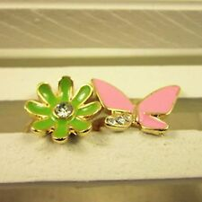 Two gold tone rings pink crystal butterfly white flower