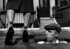 Vintage style Pin-up girl in stockings with man in manhole looking on, Re-print