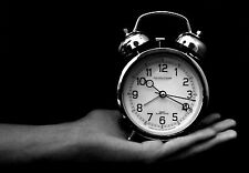 Framed Print - Black & White View of an Old Alarm Clock on a Hand(Picture Poster