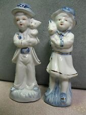 Blue & White Porcelain Figurines of Children Holding Their Pets