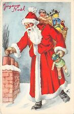 B84664  santa with toy on chimney  france  santa claus papa noel