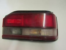 1988--1989 MAZDA 323  ,  RIGHT  SIDE TAIL  LIGHT . OEM.