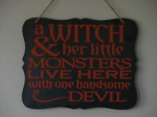 a witch and her little monsters one handsome devil Halloween hanging plaque sign