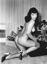Bettie Page kneeling nude with black pumps on black pillows 5 x 7 Photograph