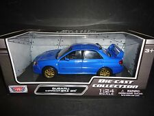 Motormax Subaru Impreza WRX STI Blue with Gold Rims 1/24