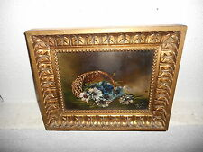Antique oil painting,{ Flowers in a basket, is signed, nice frame! }.