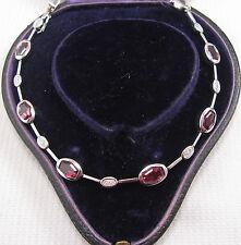 A Pretty Garnet & Diamond Bracelet set in 9ct White Gold