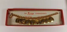 VINTAGE 1958 THE TEEN COMMANDMENTS 18K GOLD PLATED CHARM BRACELET NEW IN BOX