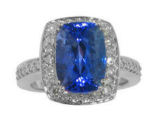 8.37 CT. TW Cushion Cut Tansanite In Round Diamond Halo Accented 14 KT Ring