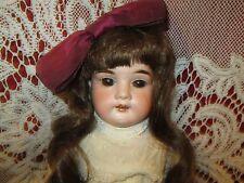 Antique German bisque head marked  L H K , kid body
