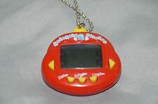 Original RakuRaku DinoKun Dinkie Dino Electronic Virtual Pet (Red)