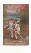 CHARMING POSTCARD OF A GIRL AND BOY WHO IS HOLDING A FISH -E.M.No 382