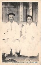 KOREA ~ OLD MAN & WOMAN POSE IN FRONT OF THEIR HOME ~ c. 1904-14