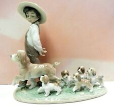 LITTLE EXPLORERS - BOY WITH PUPPY DOGS FIGURINE BY LLADRO #6828