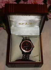 Oniss Women's Cyrstal Accented Black Ceramic Two Tone Rose Trim Watch