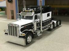 1/64 DCP WHITE/BLACK 389 PETERBILT TRI-AXLE
