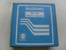 USED GENUINE SUZUKI 1982 DEALER BINDER WITH 38 SET UP & PREPARATION MANUALS
