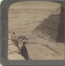 STEREOVIEW, IMAGE OF THE SECOND PYRAMID, KHEFREN, AND TWO ONLOOKERS. EGYPT.
