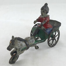 C. 1895-1905 HORSE PULLING CLOWN DWARF IRON BELL TOY MADE BY GONG BELL MFG. CO.