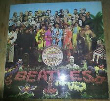 The Beatles Sgt Pepper vinyl lp. First pressing