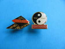 2, SUCHARD Chocolate pin badges. Good Condition