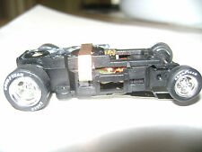 One Autoworld 4 Gear Chassis with Goodyear Tires Chrome Rims HO Slot Car Fit AW