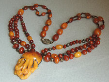 Natural Butterscotch Honey Amber Figural Carved Pendant Necklace