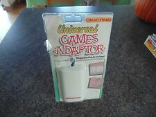 OFFICIAL GRANDSTAND UNIVERSAL HANDHELD GAME UK ADAPTOR NEW OLD STOCK SEALED 1987