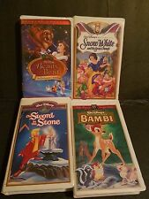 4-WALT DISNEY VHS MOVIES. BAMBI-SNOW WHITE-THE SWORD IN THE STONE- BEAUTY& BEAST