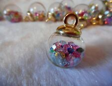 4pcs clear glass globe charms with crystal beads inside.  16mm dia