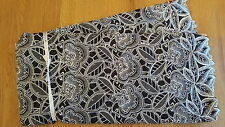 African swiss voile lace. Black with silver embroidery and rhinestones. 5 yards