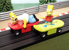 Micro Scalextric Pair 1:64 Cars - The Simpsons  Bart & Homer Simpson Skateboards