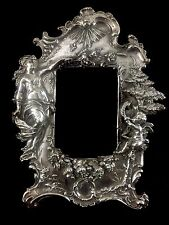 Sterling silver picture frame with Woman and Angel Blowing Horn
