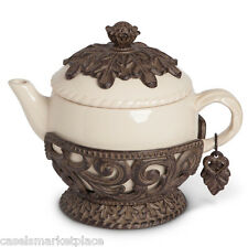 The GG Collection Acanthus Leaf Cream Ceramic Tea Pot w/ Brown Metal Base