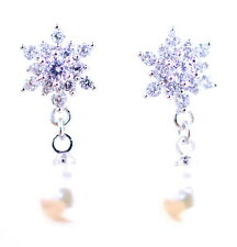 Silver tone crystal snowflake stud earrings with hanging pearl