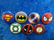"""1"""" pinback buttons inspired by """"Super Hero logos"""""""