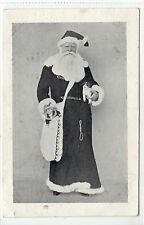 Picture postcard of Santa Claus holding doll (C13421)