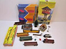 VINTAGE LOT OF N GAUGE TRAIN RAILROAD CARS BUILDINGS ATLAS TRACKS TOWER TRIX