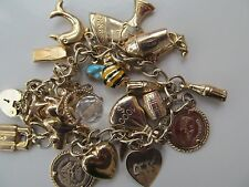 9ct gold charm bracelet and 9ct charms
