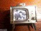 THE BEATLES STERLING SILVER MODEL 1960s TV SET CHARM WITH EARLY PHOTO OF FAB 4