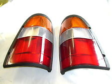 HOLDEN TF RODEO  PAIR OF NEW TAIL LIGHTS / TAIL LAMPS WITH GLOBES AND WIRING.